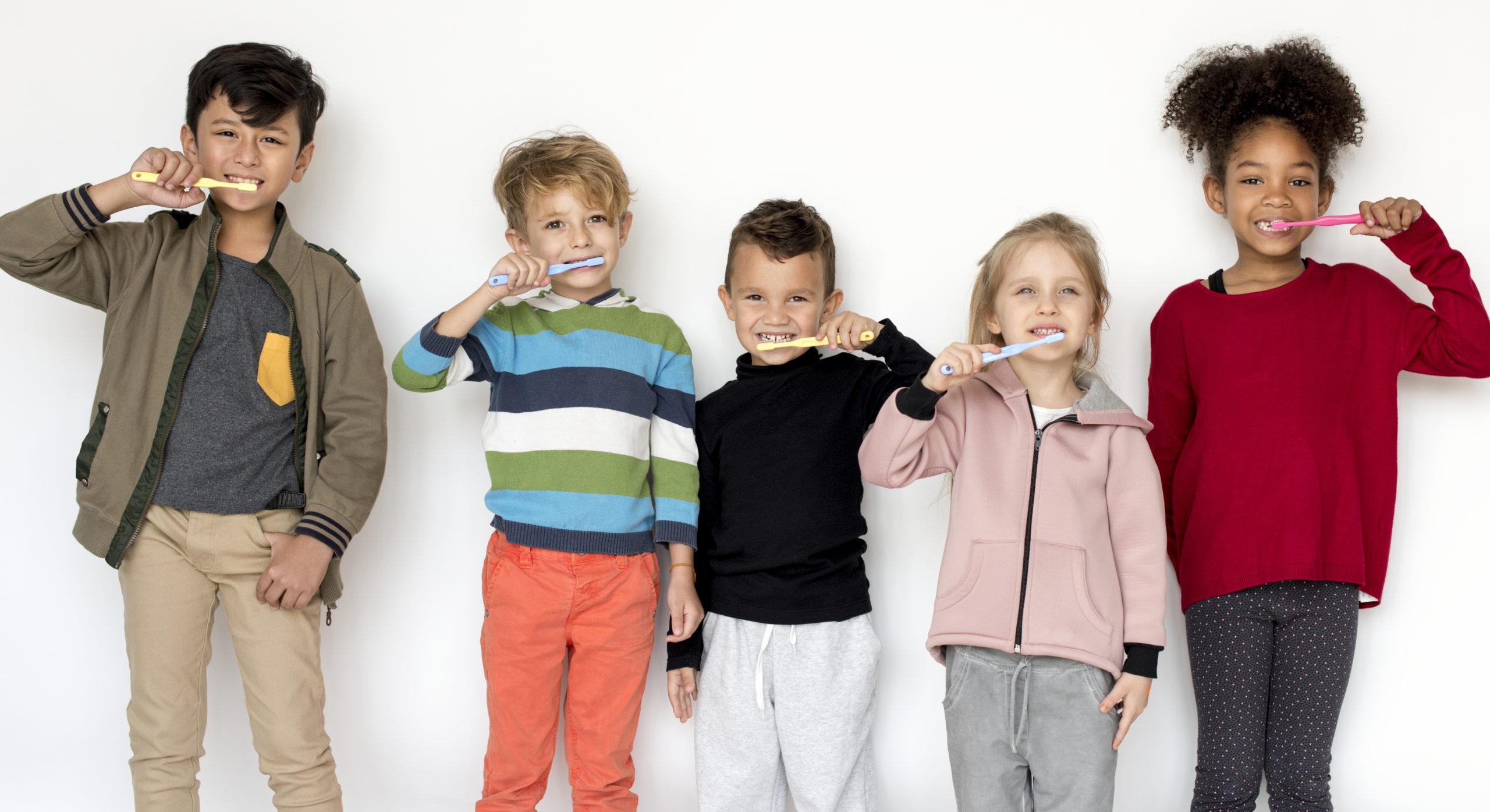 kids brushing their teeth to avoid dental problems